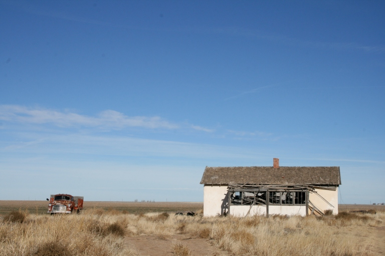 This December 2013 photo shows an abandoned building and car in rural Cimarron County in the Oklahoma Panhandle.